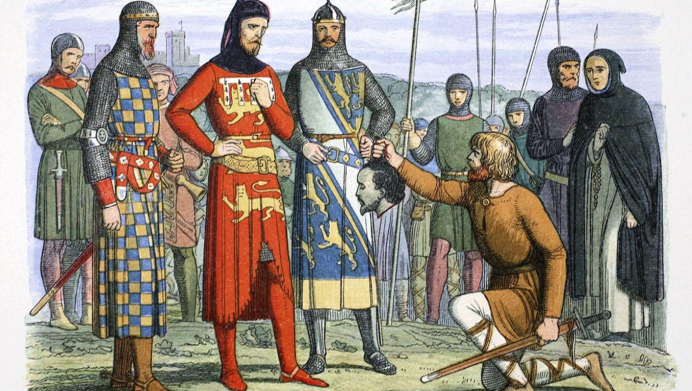 Głowa Piersa Gavestona pokazywana hrabiemu Lancaster, kuzynowi króla Tomaszowi Plantagenetowi, 1312 rok. Gaveston był ulubieńcem i zapewne kochankiem króla Edwarda II, który uczynił go hrabią Kornwalii. Swoją silną pozycją i arogancją wobec magnatów zrobił sobie wielu wrogów. Po próbach wygnania go, ostatecznie został schwytany i stracony przez zbuntowanych baronów. Rysunek Jamesa Williama Edmunda Doyle'a, XIX w. Fot. Historica Graphica Collection/Heritage Images/Getty Images
