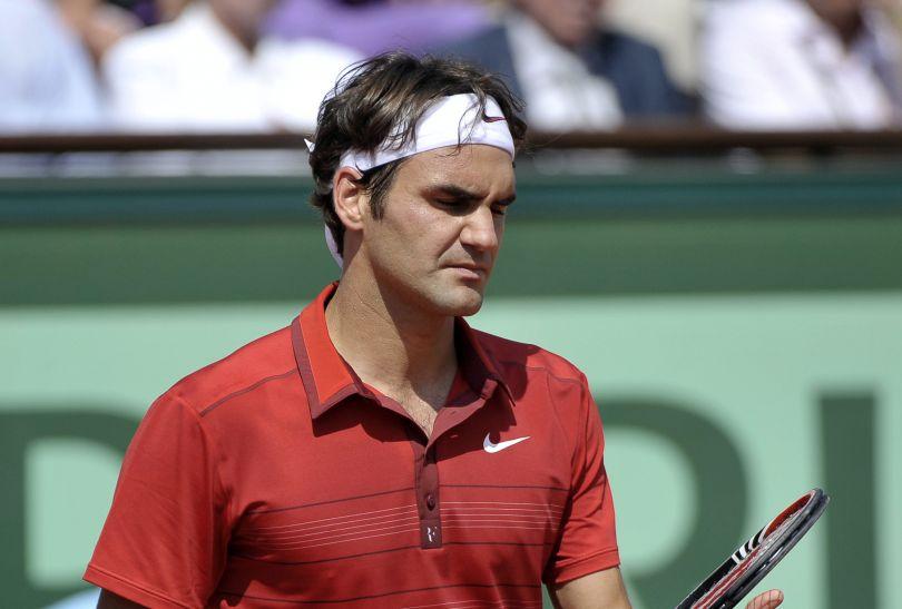 Federer po raz czwarty przegrał w finale z Nadalem (fot. PAP/EPA)