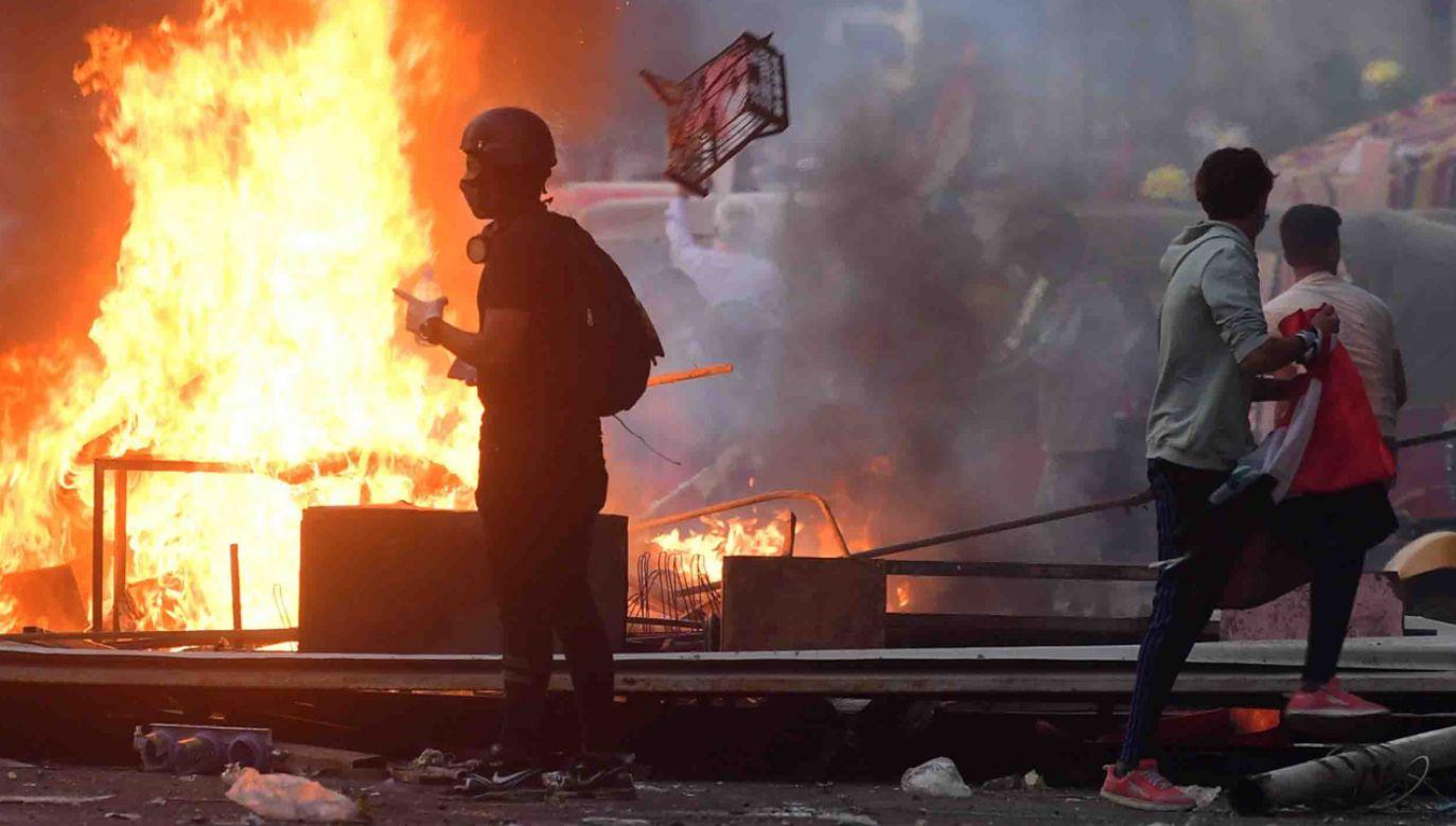 W niedzielnych protestach w Iraku zginęły trzy osoby; ponad 100 zostało rannych  (fot. PAP/EPA/MURTAJA LATEEF)