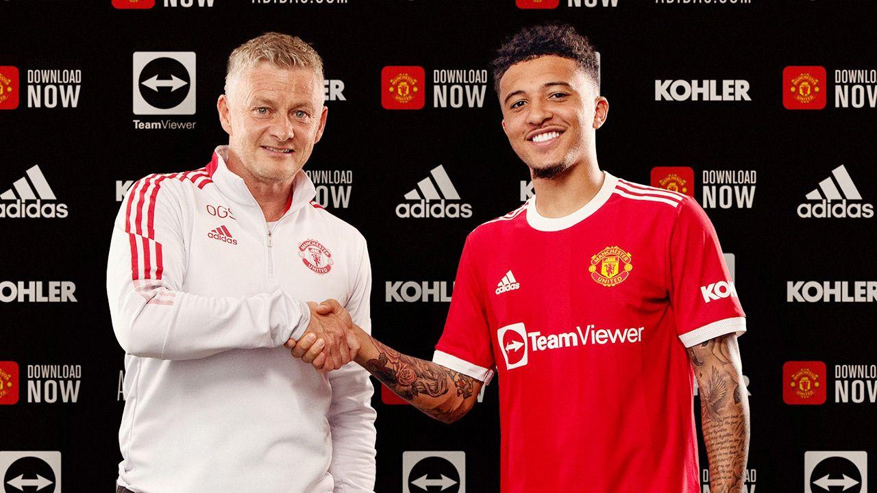 Jadon Sancho (z prawej) z trenerem Manchesteru United Ole Gunnarem Solskjaerem (fot. Ash Donelon/Manchester United via Getty Images)